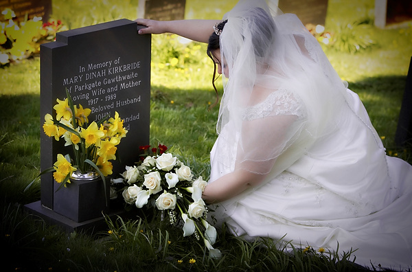 The bride lays her bouqet on her grandmothers grave, by derwent photography