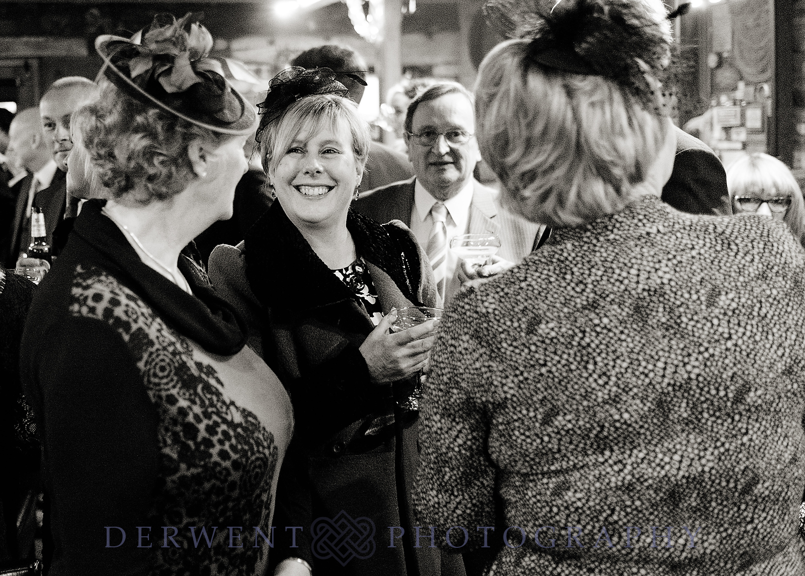 bw image of wedding guests at new house farm