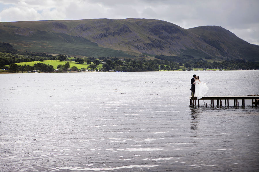 wedding couple on ullswater jetty after their wedding at Another Place Hotel