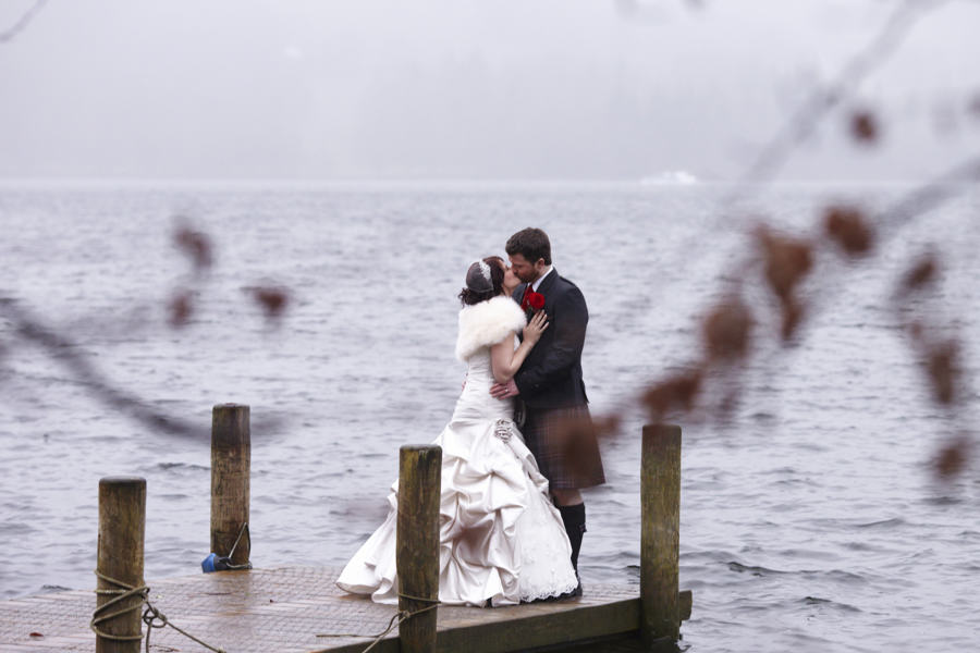 bride & groom on windermere jetty at their langdale chase wedding