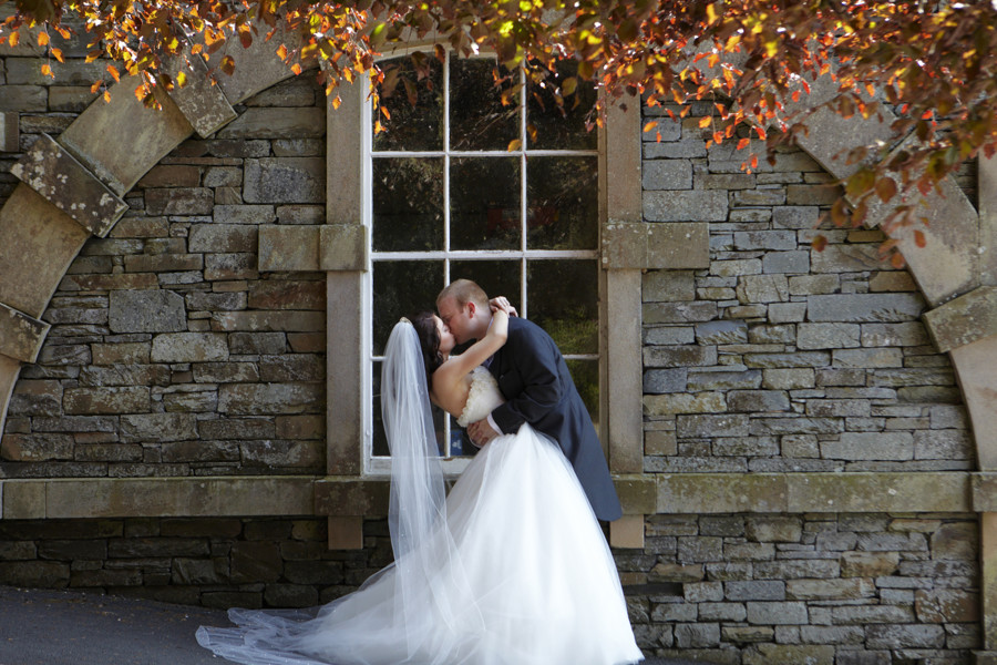 the hollywood kiss between bride & groom in the grounds of the langdale chase hotel
