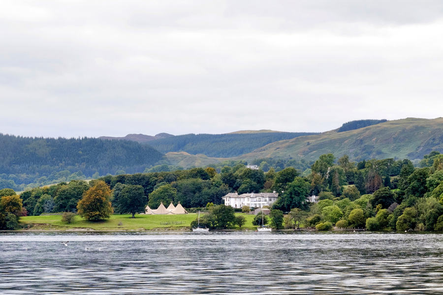 Another Place Hotel, wedding venue near penrith, with tipi marquee set up in the grounds and gardens from Ullswater