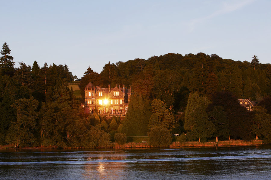 the langdale chase hotel wedding venue reflecting the setting sun taken from lake windermere